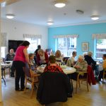 Service users enjoying a sewing session at the bright new WV Centre