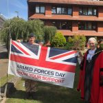 Mayor of Surrey Heath Cllr Pat Tedder with Lt Col Boryer of RMA Sandhurst and the Armed Forces Day flag